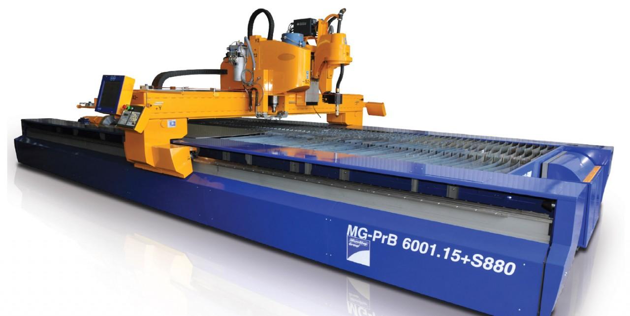 Plazmové rezacie stroje novej generácie Obr. 1 CNC stroj typu MG s plazmovou rezacou hlavou – rotátorom a vŕtacou hlavou